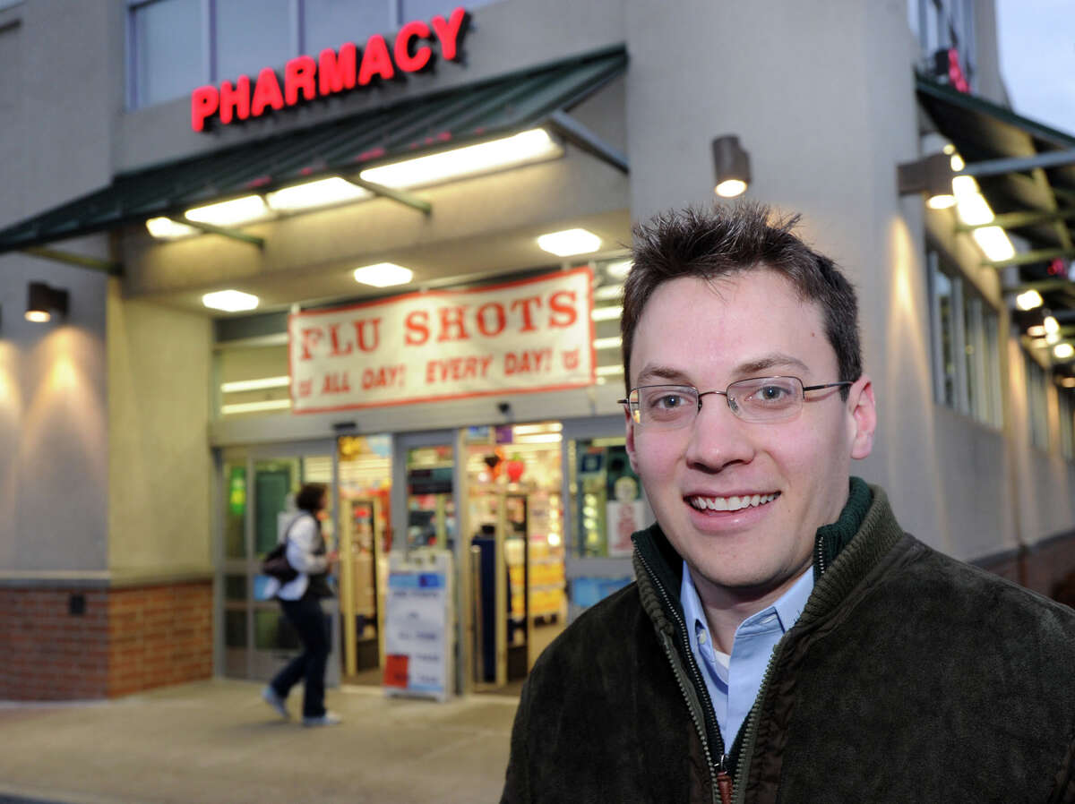 Greenwich resident Robert Wilson in front of the Walgreens Pharmacy in Old Greenwich, Wednesday, Jan. 9, 2013. Wilson said he received his flu shot at Walgreens after finding out two other pharmacies in town had run out of the vaccine.
