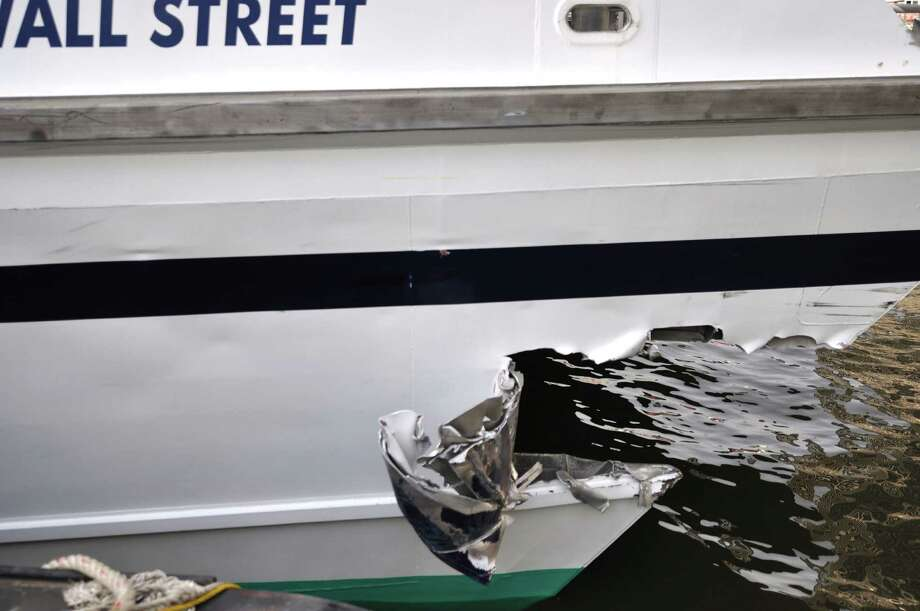 This photo provided by the U.S. Coast Guard shows the gaping hole in the hull of a high-speed passenger ferry from New Jersey after it crashed into a dock in New York, in lower Manhattan Wednesday, Jan. 9, 2013, seriously injuring 11 people. Scores of people who had been standing, waiting to disembark, were hurled to the deck or launched into walls by the impact, which came after the catamaran Seastreak Wall Street slowed following a routine trip across New York Bay and past the Statue of Liberty, passengers said. (AP Photo/ U.S. Coast Guard, Petty Officer 2nd Class, Jetta Disco) Photo: Jetta Disco