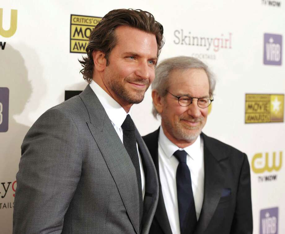 Bradley Cooper, left, and Steven Spielberg arrive. Photo: John Shearer/Invision/AP