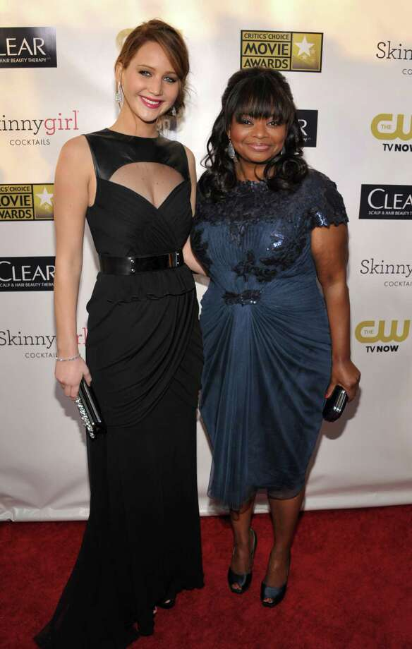 Jennifer Lawrence, left,  and Octavia Spencer arrive. Photo: John Shearer/Invision/AP
