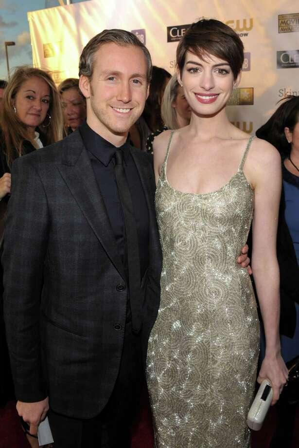 Adam Shulman, left, and Anne Hathaway arrive. Photo: John Shearer/Invision/AP