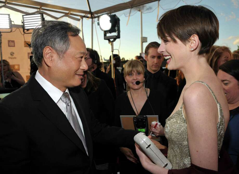 Director Ang Lee, left, and Anne Hathaway are seen as they arrive. Photo: John Shearer/Invision/AP