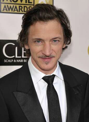 John Hawkes arrives. Photo: John Shearer/Invision/AP