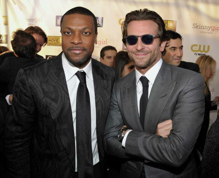 Chris Tucker, left, and Bradley Cooper arrive at the ceremony. Photo: John Shearer/Invision/AP