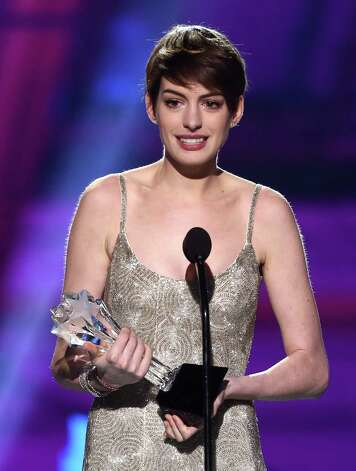 "Anne Hathaway accepts the award for best supporting actress for ""Les Miserables."" Photo: Matt Sayles/Invision/AP"