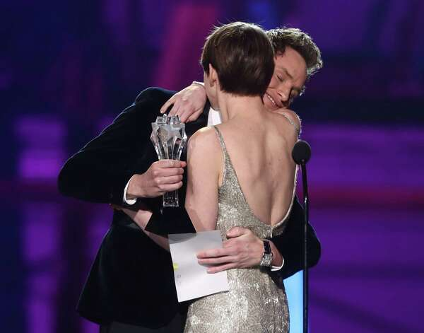 "Eddie Redmayne, left, presents Anne Hathaway with the award for best supporting actress for ""Les Miserables."" Photo: Matt Sayles/Invision/AP"