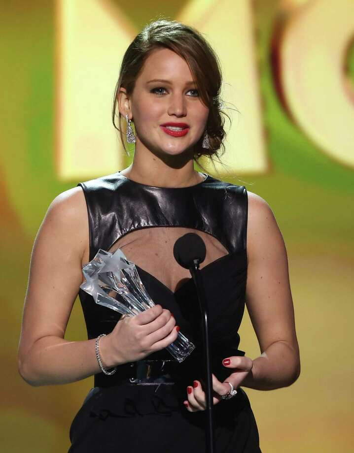 "Jennifer Lawrence accepts the award for best actress in an action movie for ""The Hunger Games."" Photo: Matt Sayles/Invision/AP"