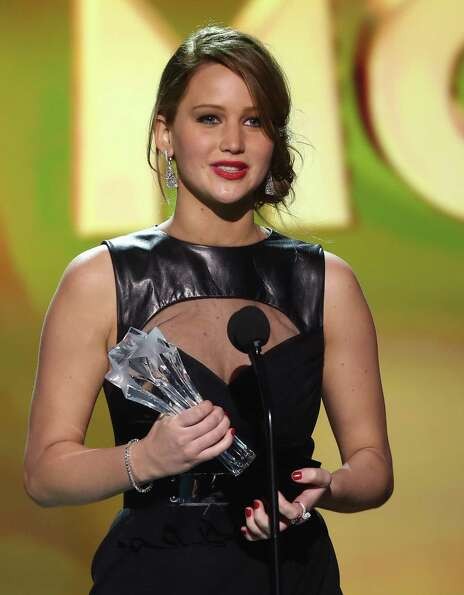 Jennifer Lawrence accepts the award for best actress in an action movie for