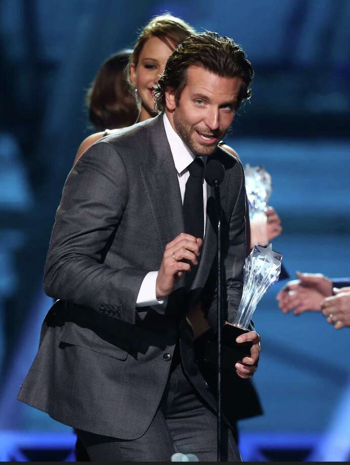 """Bradley Cooper accepts the award for best acting ensemble for """"Silver Linings Playbook."""" Photo: Matt Sayles/Invision/AP"""