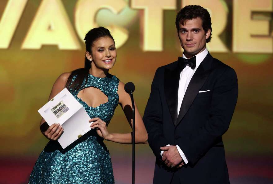 Nina Dobrev, left, and Henry Cavill present the best young actor award.