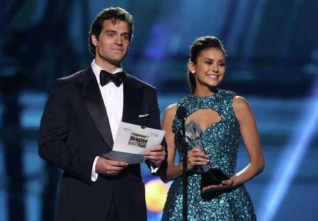 Nina Dobrev, right, and Henry Cavill present the best acting ensemble. Photo: Matt Sayles/Invision/AP