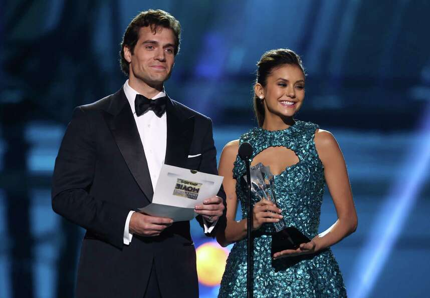 Nina Dobrev, right, and Henry Cavill present the best acting ensemble.