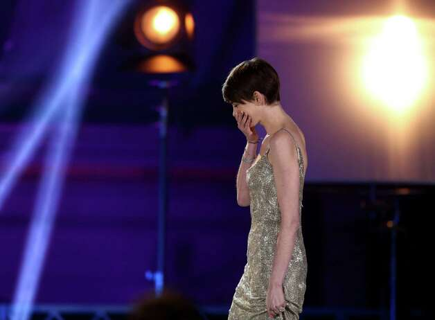 "Anne Hathaway is seen as she goes on stage to accept the award for best supporting actress for ""Les Miserables."" Photo: Matt Sayles/Invision/AP"