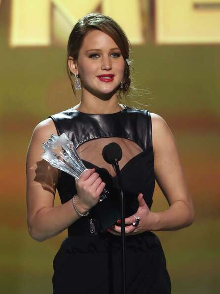 Jennifer Lawrence accepts the award for best actress in a comedy for