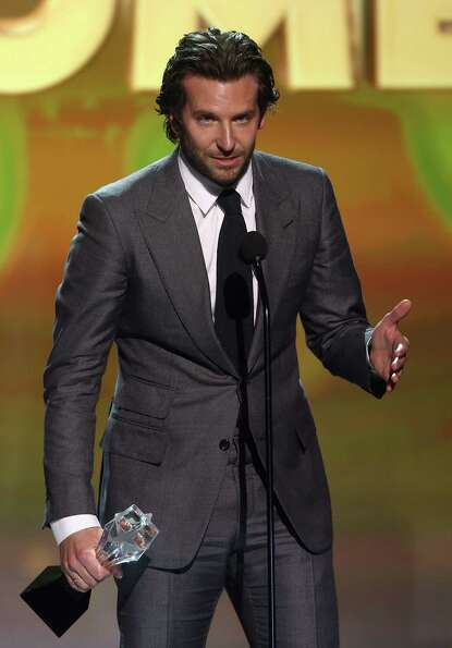 Bradley Cooper accepts the award for best actor in a comedy for