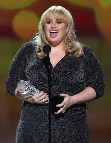 Rebel Wilson presents the Critics' Choice Louis XIII Genius Award to Judd Apatow. Photo: Matt Sayles/Invision/AP