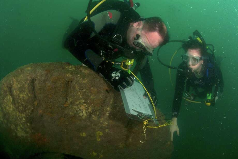 Matt Keith and Amanda Evans are among the divers who mapped the USS Hatteras wreckage, 20 miles out in the Gulf. Photo: Jesse Cancelmo, Freelance / © 2012 Houston Chronicle