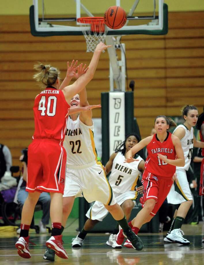 Siena's Lily Grenci trys to block a pass by Fairfield's Kristin Schatzlein  Thursday, Jan. 10, 2013, in Loudonville, N.Y. (Michael P. Farrell/Times Union) Photo: Michael P. Farrell