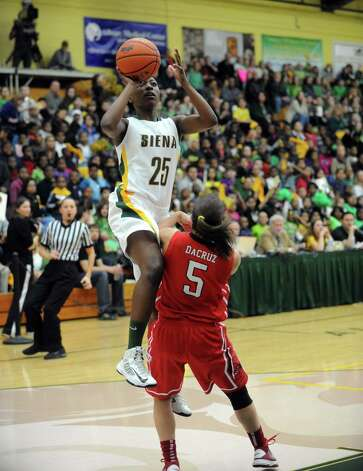 Siena's Tehresa Coles goes to the basket during a midday game against Fairfield Thursday, Jan. 10, 2013. in Loudonville, N.Y. (Michael P. Farrell/Times Union) Photo: Michael P. Farrell