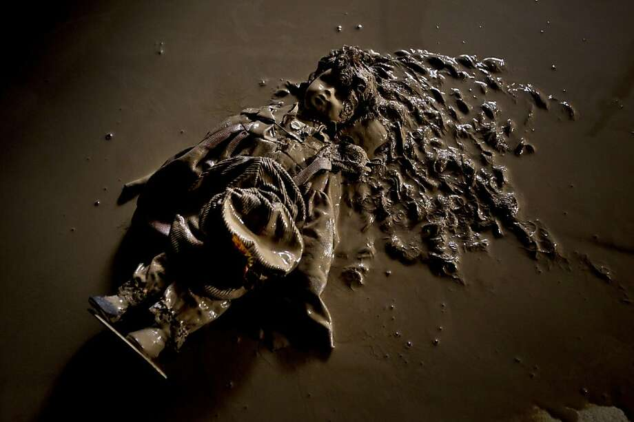 A doll covered with mud lies on the floor after a flood hit the village of Bat Hefer, central Israel, Wednesday, Jan. 9, 2013. About 200 homes were flooded and tens of cars were damaged by the flood. Photo: Ariel Schalit, Associated Press