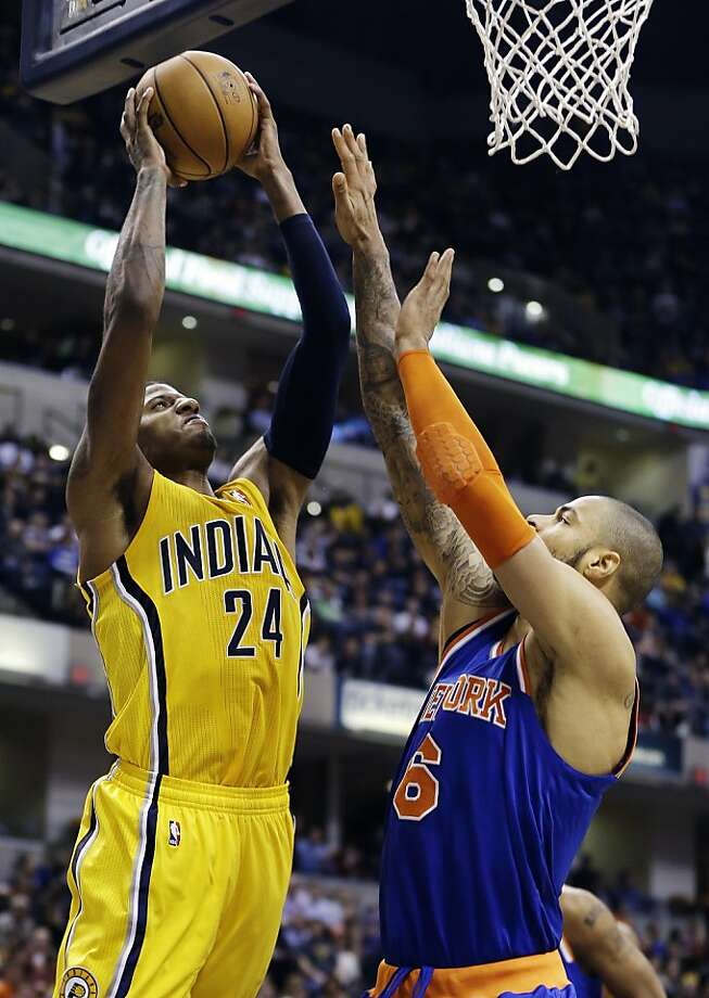 Indiana's Paul George, who scored 24 points, looks for a shot against the Knicks' Tyson Chandler. Photo: Darron Cummings, Associated Press