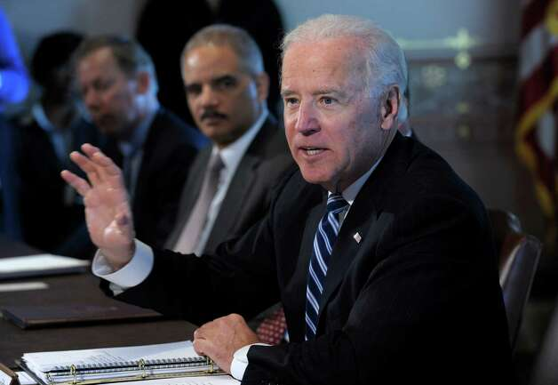 Vice President Joe Biden, accompanied by Attorney General Eric Holder, gestures as he speaks during a meeting with Sportsmen and Women and Wildlife Interest Groups and member of his cabinet, Thursday, Jan. 10, 2013,  in the Eisenhower Executive Office Building on the White House complex in Washington. Biden is holding a series of meetings this week as part of the effort he is leading to develop policy proposals in response to the Newtown, Conn., school shooting (AP Photo/Susan Walsh) Photo: Susan Walsh