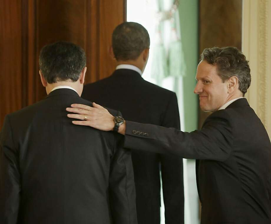Outgoing Treasury Secretary Timothy Geithner, right, pats the back of current Chief of Staff Jack Lew, left, as they walk out with President Barack Obama from the East Room of the White House in Washington, Thursday, Jan. 10, 2013, after Obama announced he will nominate Lew to succeed Geithner as treasury secretary. Photo: Pablo Martinez Monsivais, Associated Press