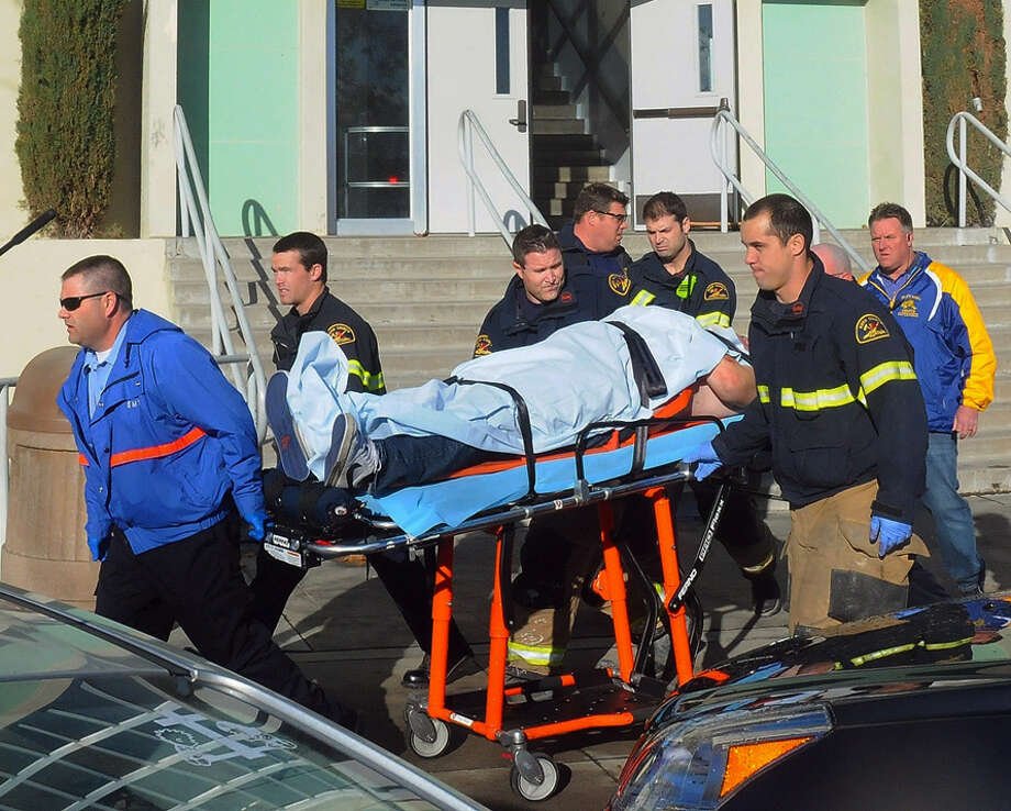 This image provided by the Taft Midway Driller/Doug Keeler shows paramedics transporting a student wounded during a shooting Thursday Jan. 10, 2013 at San Joaquin Valley high school in Taft, Calif. Authorities said a student was shot and wounded and another student was taken into custody. (AP Photo/Taft  Midway Driller, Doug Keeler)  MANDATORY CREDIT Photo: HOEP