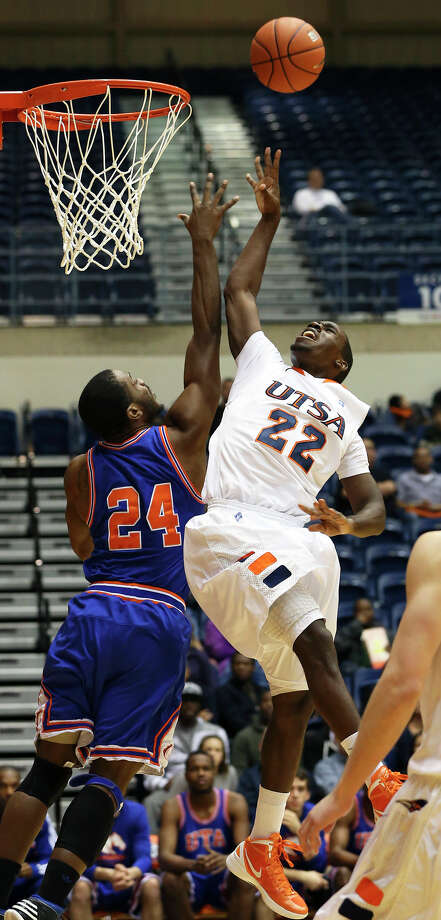 Kannon Burrage gets fouled on the way up by Maverick defender Kevin Butler as UTSA plays UTA at the UTSA Convocation Center in men's basketball on January 10, 2013. Photo: Tom Reel, Express-News / ©2012 San Antono Express-News