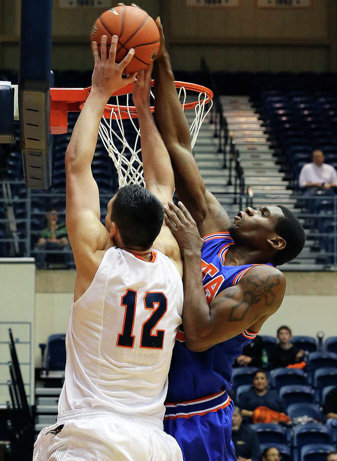 Maverick forward Brandon Edwards rejects Jeromie Hill at the bucket as UTSA plays UTA at the UTSA Convocation Center in men's basketball on January 10, 2013. Photo: Tom Reel, Express-News / ©2012 San Antono Express-News