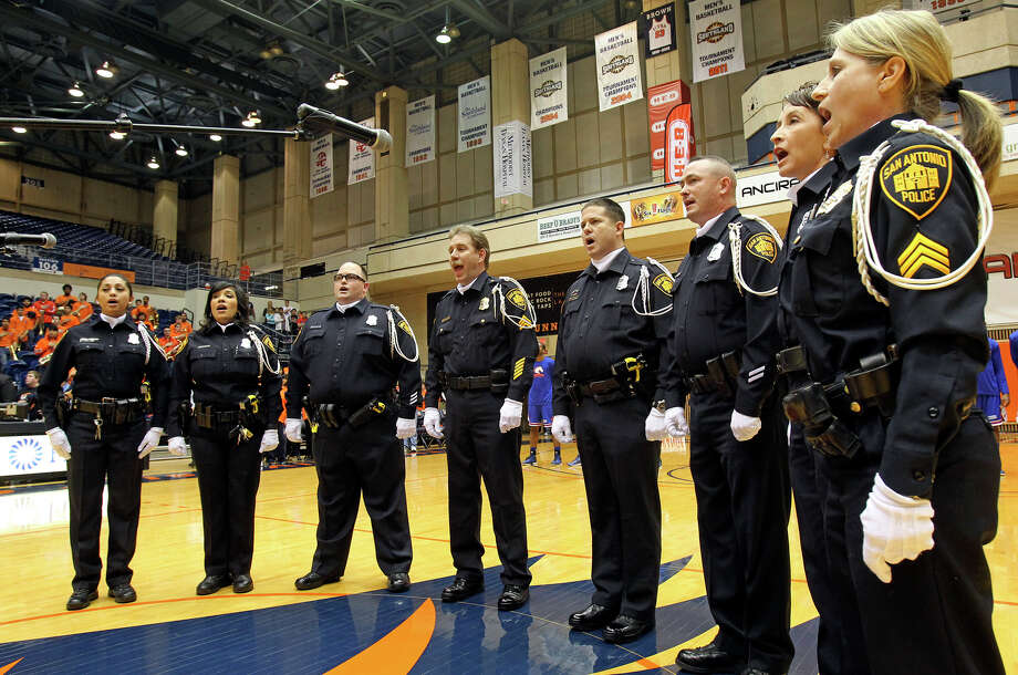Members of the SAPD choir sing the national anthem before UTSA plays UTA at the UTSA Convocation Center in men's basketball on January 10, 2013. Photo: Tom Reel, Express-News / ©2012 San Antono Express-News