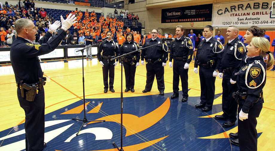The SAPD Choir sings the national anthem before UTSA plays UTA at the UTSA Convocation Center in men's basketball on January 10, 2013. Photo: Tom Reel, Express-News / ©2012 San Antono Express-News