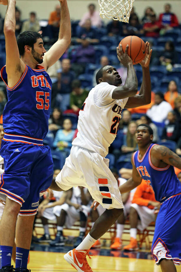 Roadrunner guard Kannon Burrage gets a shot off around Jordan Reves as UTSA plays UTA at the UTSA Convocation Center in men's basketball on January 10, 2013. Photo: Tom Reel, Express-News / ©2012 San Antono Express-News