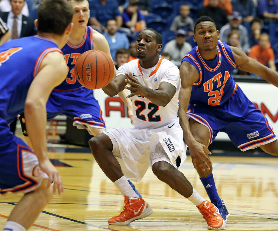 Roadrunner guard Kannon Burrage loses the ball as Cameron Catlett pokes it away from behind as UTSA plays UTA at the UTSA Convocation Center in men's basketball on January 10, 2013. Photo: Tom Reel, Express-News / ©2012 San Antono Express-News