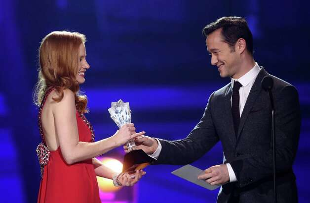 Joseph Gordon-Levitt, right,  presents the award for best actress to Jessica Chastain. Photo: Matt Sayles/Invision/AP