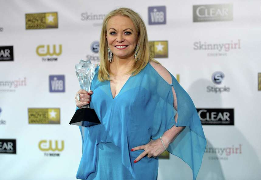 Jacki Weaver poses backstage with the award for best comedy movie for