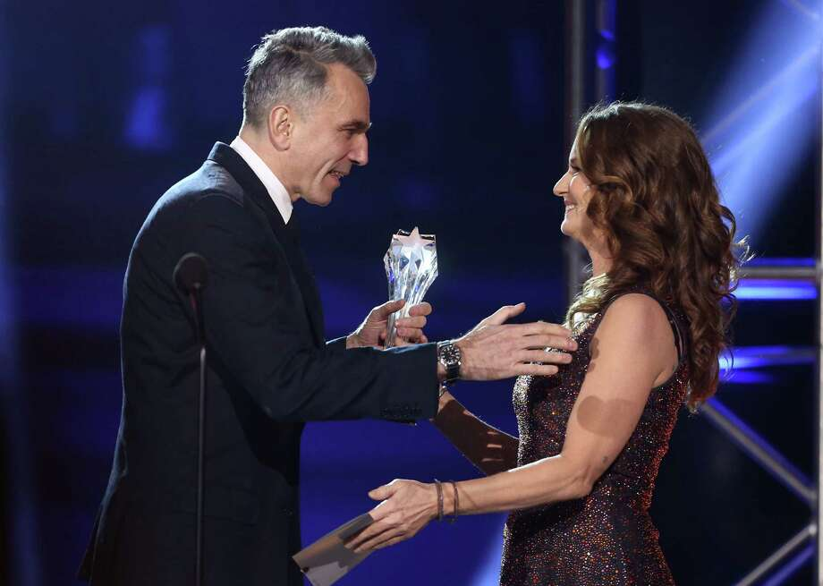 Melissa Leo, right, presents the award for best actor to Daniel Day-Lewis. Photo: Matt Sayles/Invision/AP
