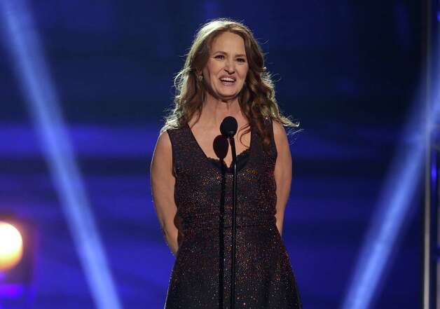 Melissa Leo presents an award for best actor. Photo: Matt Sayles/Invision/AP