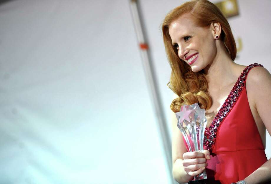 "Jessica Chastain poses backstage with the award for best actress for ""Zero Dark Thirty."" Photo: John Shearer/Invision/AP"