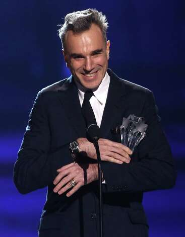 "Daniel Day-Lewis accepts the award for best actor for ""Lincoln."" Photo: Matt Sayles/Invision/AP"