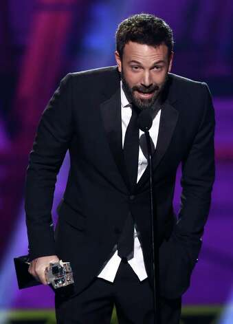 "Ben Affleck accepts the award for best director for ""Argo."" Photo: Matt Sayles/Invision/AP"