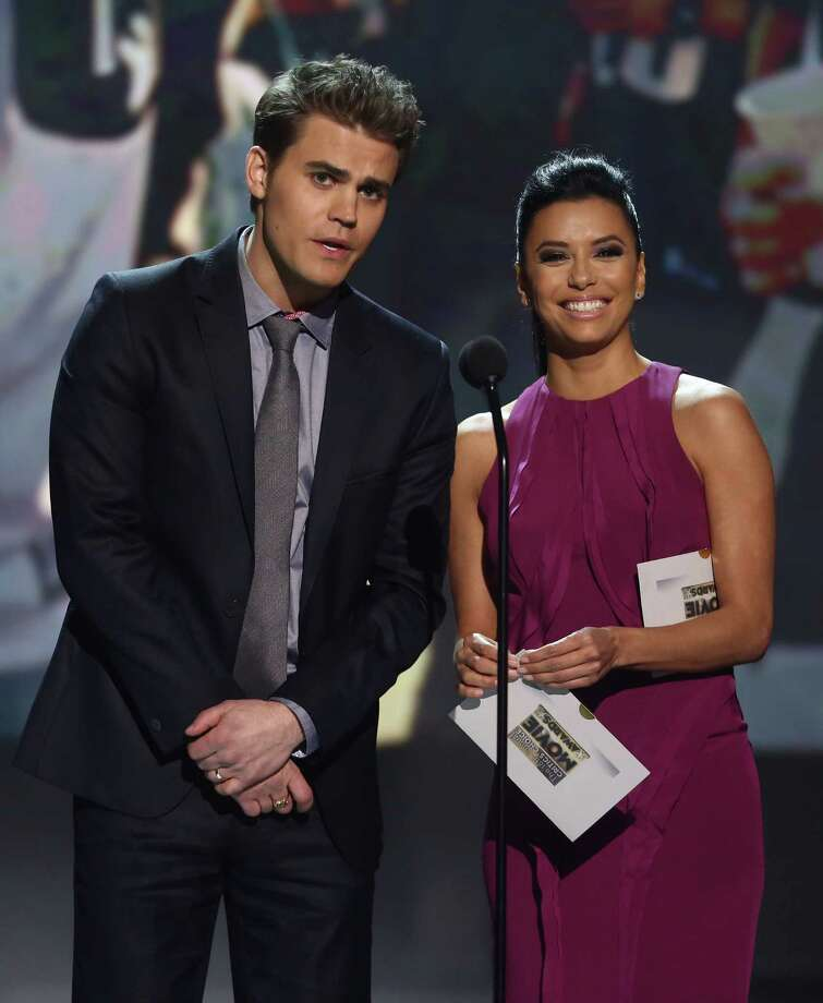 Paul Wesley, left and Eva Longoria present the award for best actor in a comedy. Photo: Matt Sayles/Invision/AP