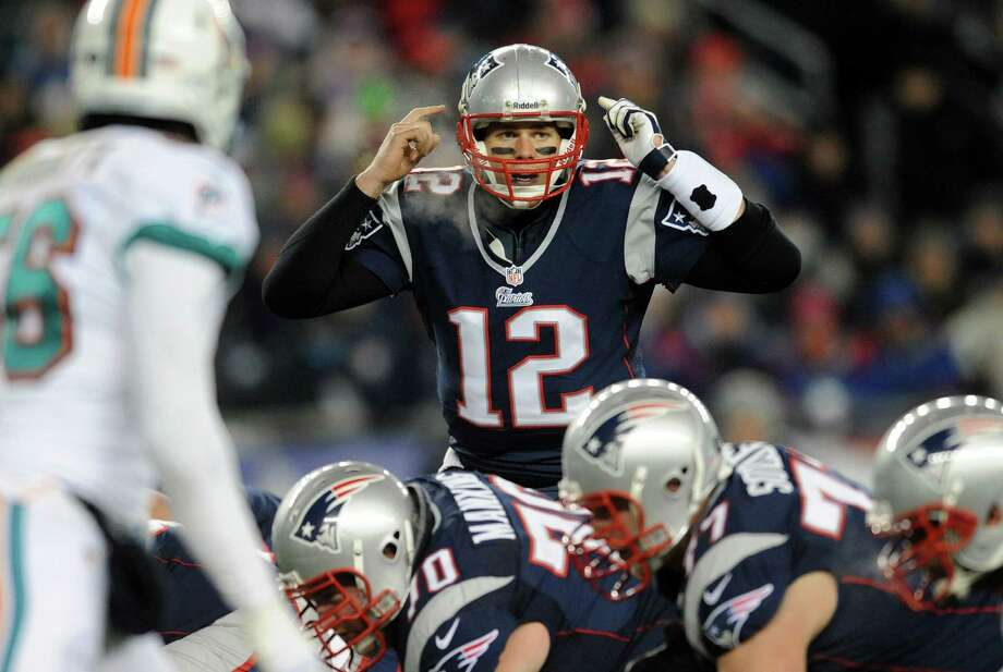 Patriots quarterback Tom Brady leads the fast-paced attack that has resulted in the highest-scoring offense in the NFL and often leaves opponents scratching their heads. Photo: Jim Rassol, MBR / Sun Sentinel