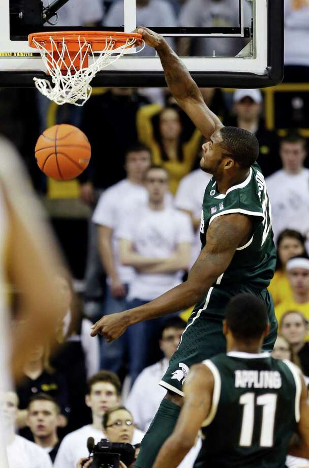 Michigan State guard Branden Dawson dunks during the second half of an NCAA college basketball game against Iowa, Thursday, Jan. 10, 2013, in Iowa City, Iowa. Dawson scored a career-high 17 points as Michigan State won 62-59. (AP Photo/Charlie Neibergall) Photo: Charlie Neibergall