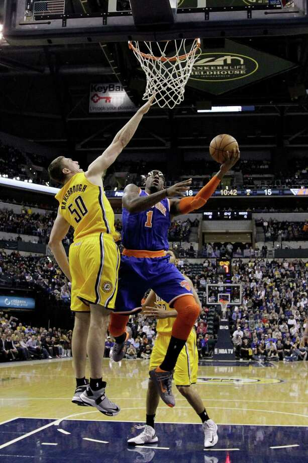 New York Knicks' Amare Stoudemire (1) shoots against Indiana Pacers' Tyler Hansbrough (50) during the first half of an NBA basketball game, Thursday, Jan. 10, 2013, in Indianapolis. (AP Photo/Darron Cummings) Photo: Darron Cummings