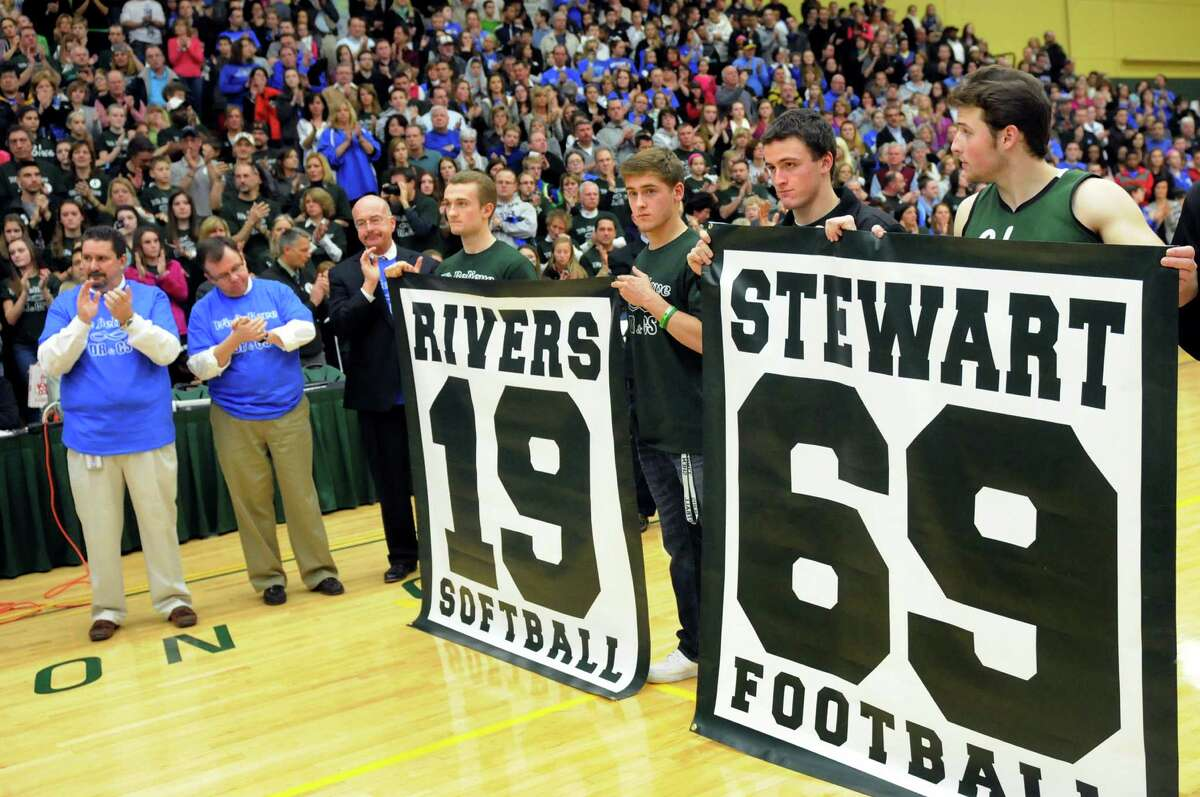 The Shenendehowa jersey numbers of Deanna Rivers and Chris Stewart are retired during a ceremony on Thursday, Jan. 10, 2013, at Siena College in Loudenville, N.Y. Shaker and Shenendehowa girls and boys basketball teams played games to benefit the memorial scholarship funds for the two athletes, who were both killed in a recent car crash. (Cindy Schultz / Times Union)
