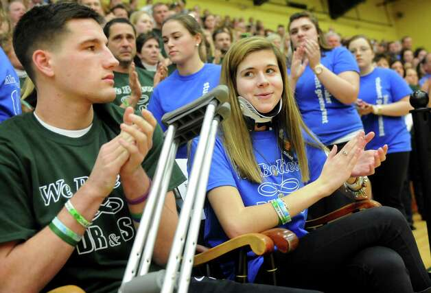 Bailey Wind, 17, center, and Matt Hardy, 17, applaud at introductions during a ceremony on Thursday, Jan. 10, 2013, at Siena College in Loudonville, N.Y. Shaker and Shenendehowa girls and boys basketball teams played games to benefit the memorial scholarship funds for Chris Stewart and Deanna Rivers, Shenendehowa athletes who were both killed in a recent car crash. (Cindy Schultz / Times Union) Photo: Cindy Schultz / 00020711A