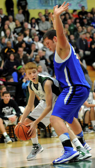 Shenedehowa's Kevin Huerter (3), left, looks to get past Shaker's David Morrison (42) during their b