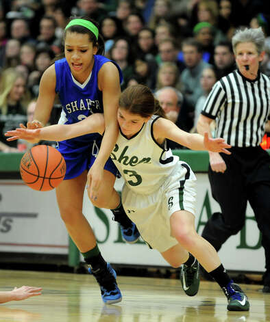Shaker's Merrick Rowland (33), left, and Shenedehowa's Madison Shea (3) battle for a loose ball during their basketball game on Thursday, Jan. 10, 2013, at Siena College in Loudonville, N.Y. (Cindy Schultz / Times Union) Photo: Cindy Schultz / 00020711A