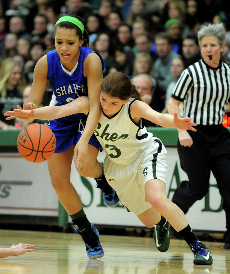 Shaker's Merrick Rowland (33), left, and Shenedehowa's Madison Shea (3) battle for a loose ball during their basketball game on Thursday, Jan. 10, 2013, at Siena College in Loudenville, N.Y. (Cindy Schultz / Times Union) Photo: Cindy Schultz / 00020711A